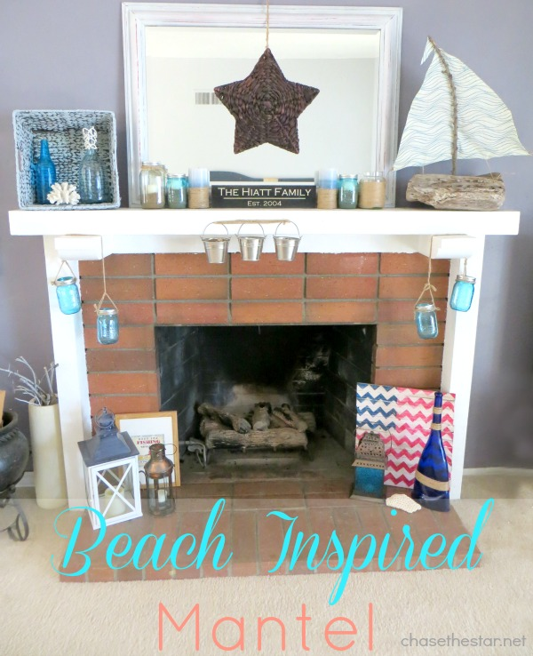 Beach Inspired Mantel via hellolifeonline.com #mantel @beach #decor #jar #beach #sand #lantern #sailboat