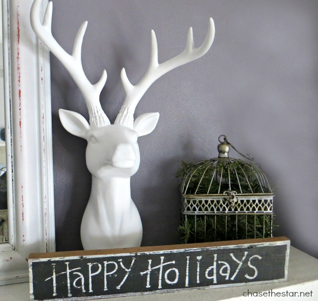 Happy Holidays Vignette via Chase the Star #staghead #deerhead #christmas #mantel #whitechristmas