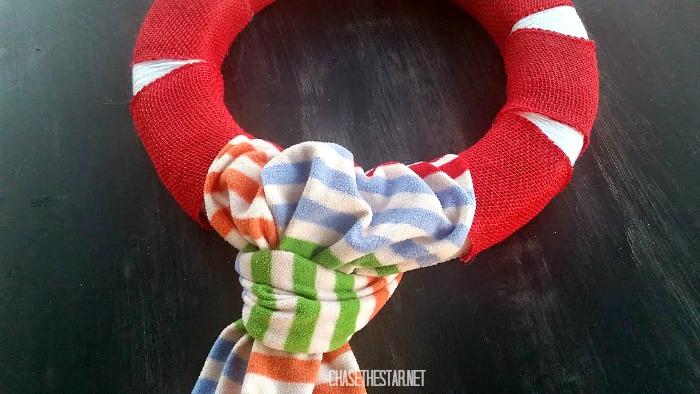 Tie a scarf around a wreath for a cozy winter look! #wreath #floracraft