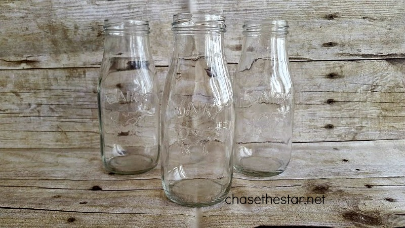 Upcycled Milk Bottles into a cute kid's table #centerpiece via Chase the Star