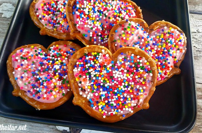 Pretzel Hearts- These fun Valentine's treats are the cutest dessert for Valentine's Day or any time you want to show you care. Easy recipe, add sprinkles or other toppings, adorable!