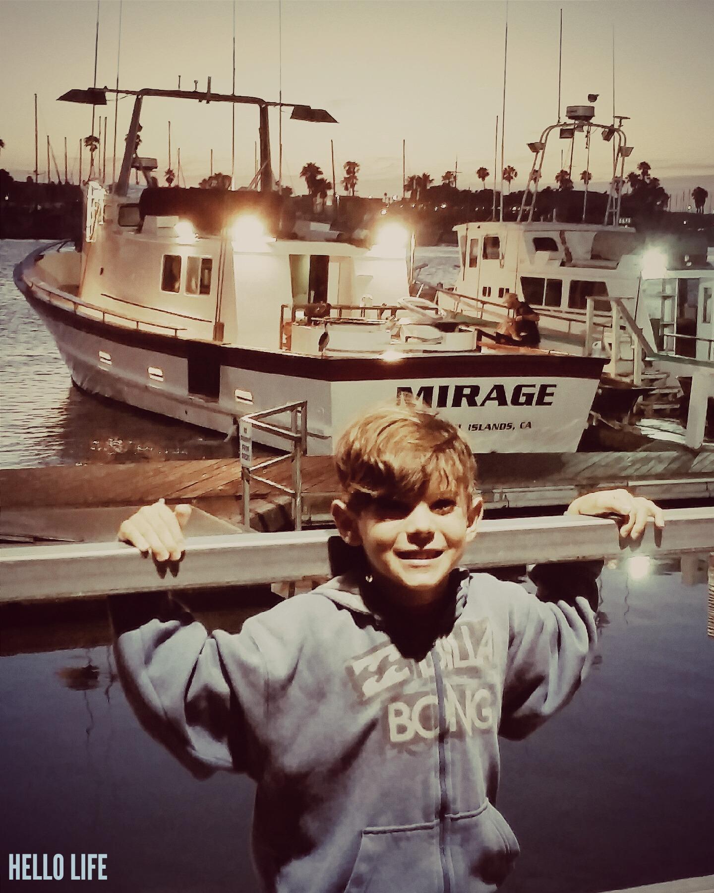 Boy on a boat dock via Hello Life hellolifeonline.com