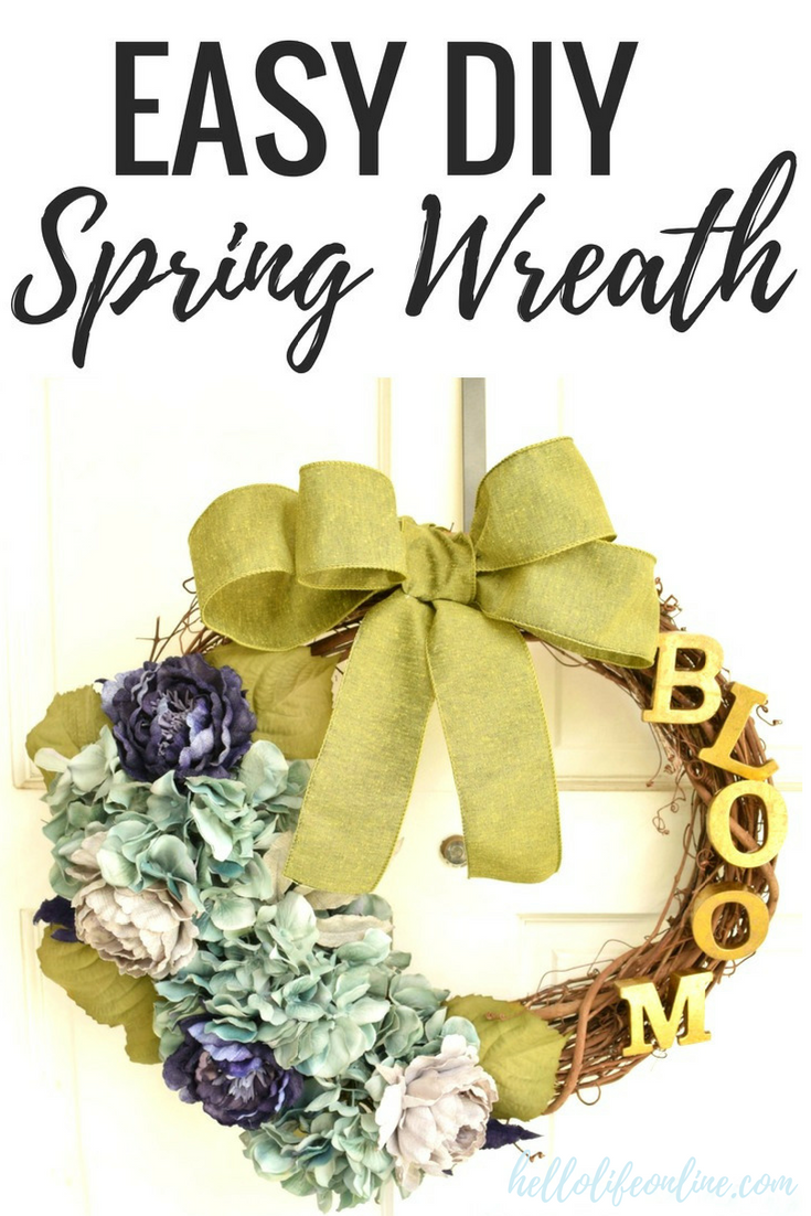 DIY Spring Wreath- This rustic yet elegant spring wreath for the front door or anywhere in your home is perfect way to ring in the spring! Start with a simple grapevine wreath and create your own!