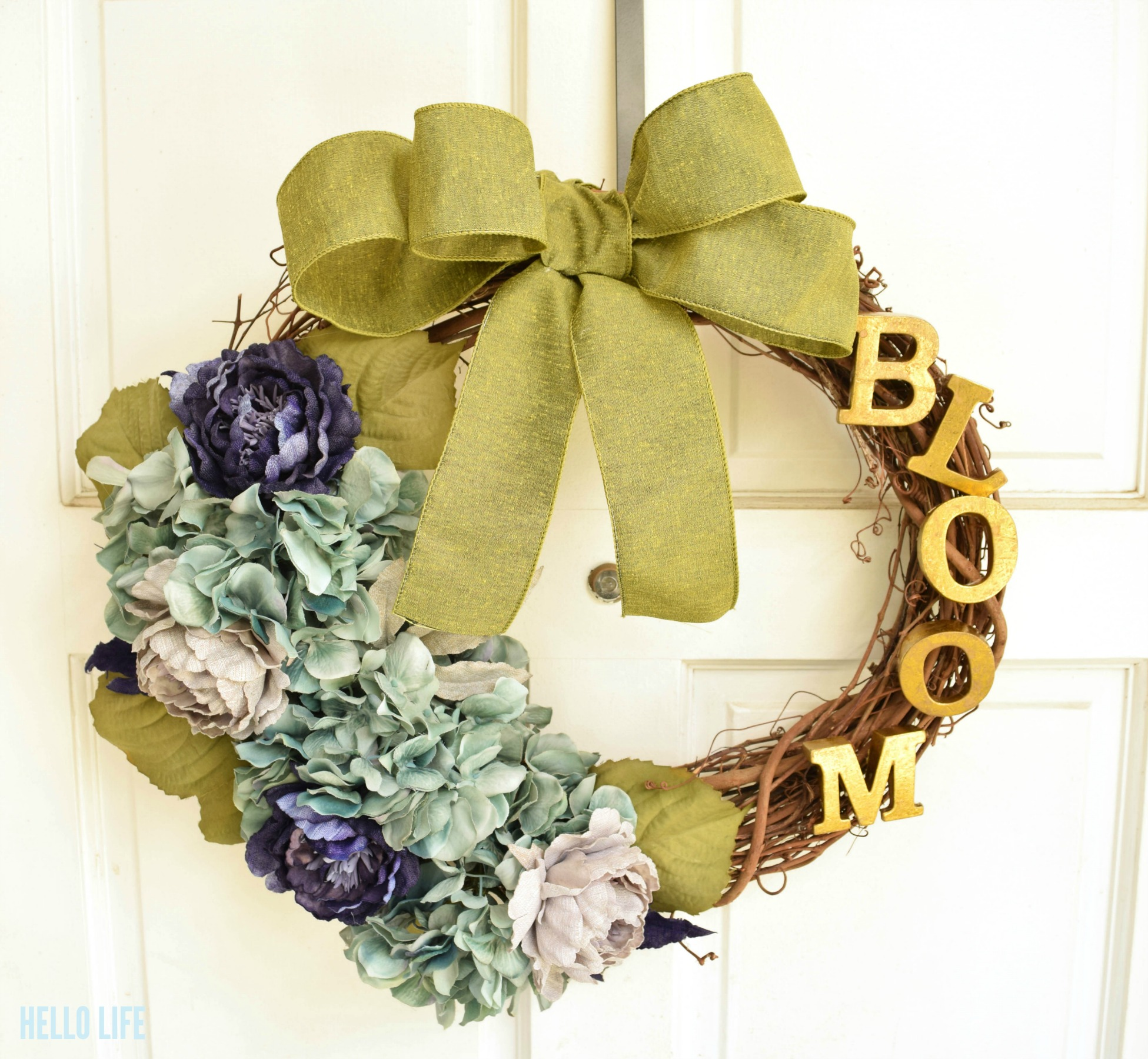 """Nothing says """"Spring"""" like flowers in bloom! Love this Spring Floral Wreath! 