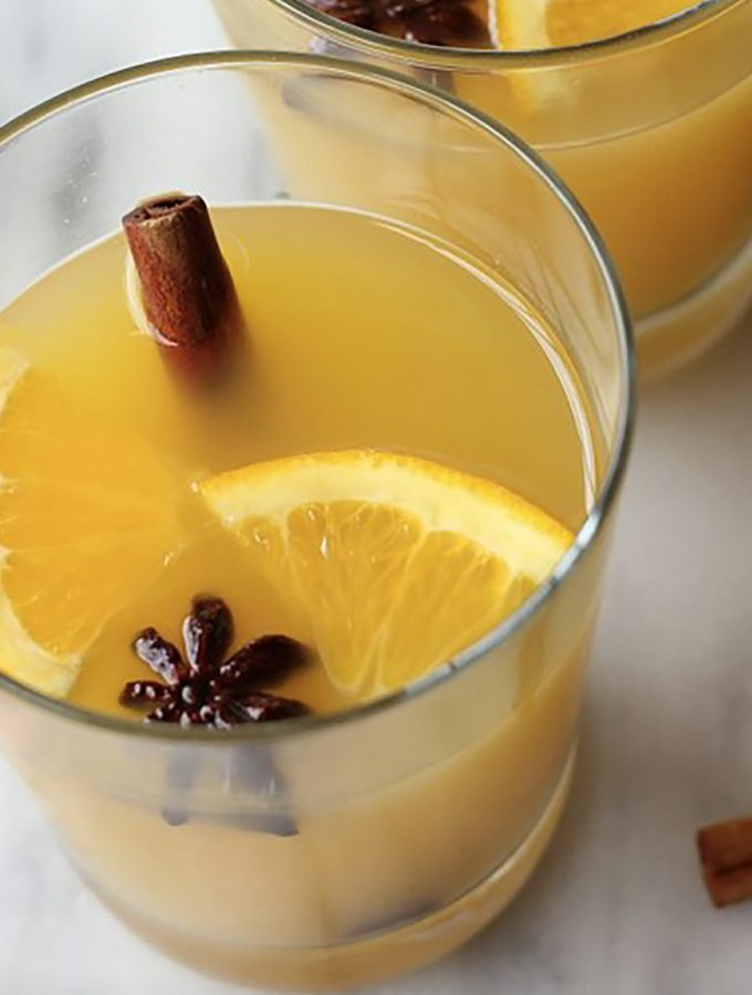 This recipe is perfect for a winter night by the fire! Festive Orange Cinnamon Blossom Cocktail